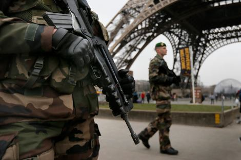 "French soldiers patrol near the Eiffel Tower in Paris as part of the highest level of ""Vigipirate"" security plan after a shooting at the Paris offices of Charlie Hebdo"